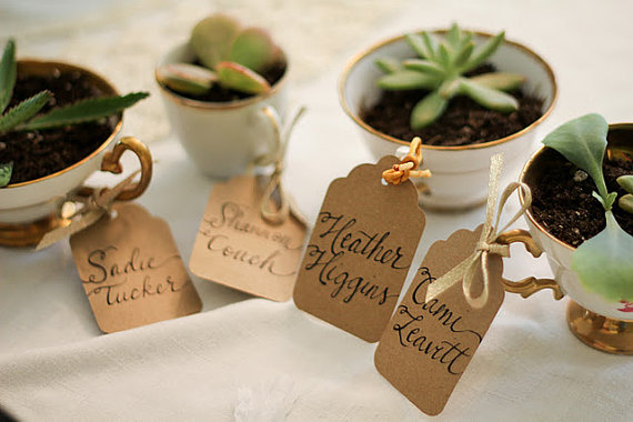 24309_teacup_name_tags_or_escort_cards_kraft_paper_tags_and_calligraphy_featured_on_style_me_pretty_1350406938_593